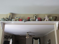 Use an over the door shelf for collectibles