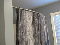 Bowed Shower Curtain Rods Add Room